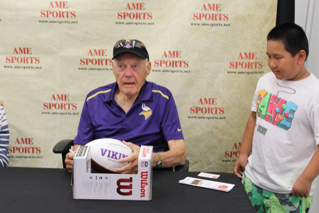 Autographed footballs, vikings apparel, and sports memorabilia